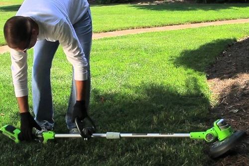 Man Starting GreenWorks 27032 Lawn Edger