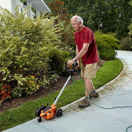 Senior Man Using WORX WG896 Lawn Edger